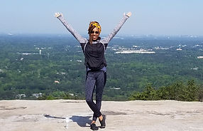 Image of Y'Na at the top of a mountain