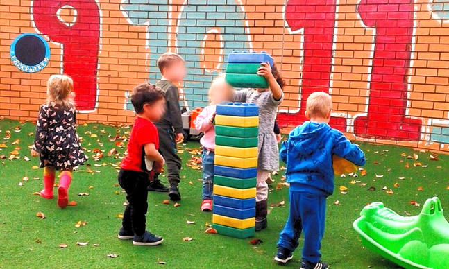 Children playing with blocks outside