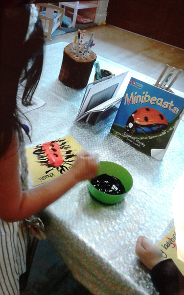 Child reading and painting nature.jpg