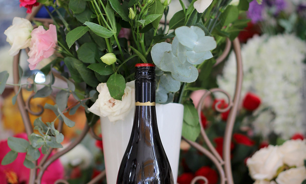 Seasonal flowers and Pinot Noir wine - $140 - $160