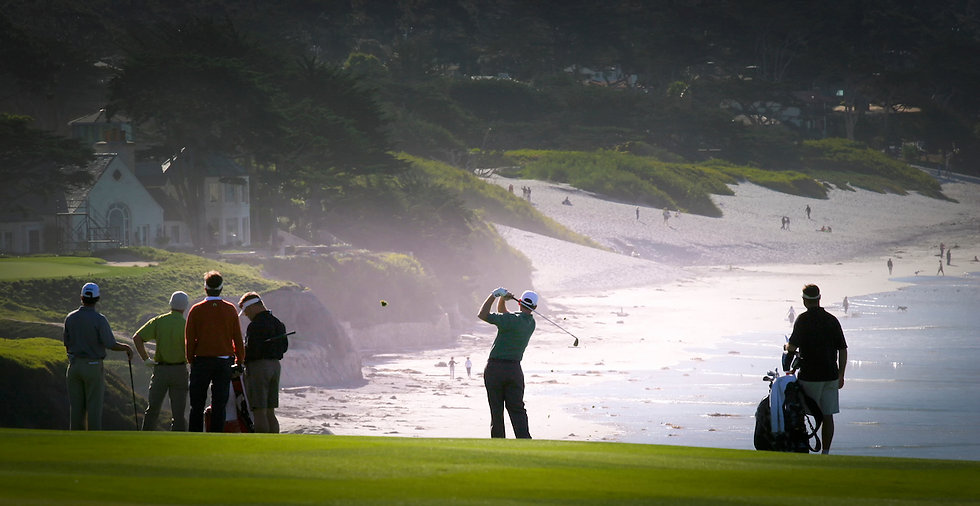 Golfers playing on beach golf course wit