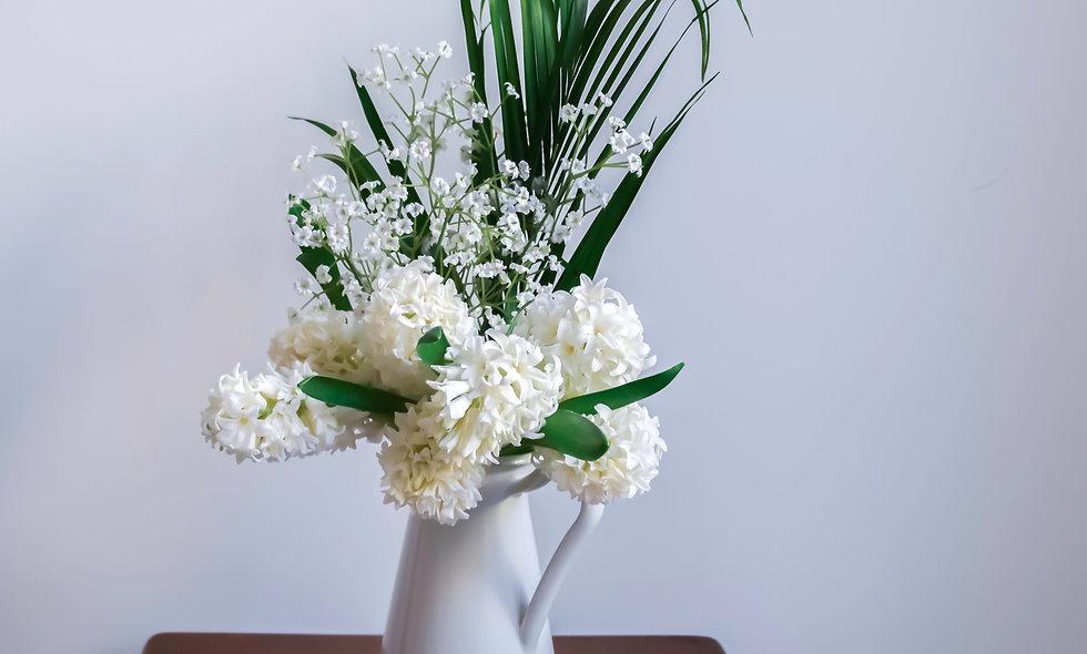Serenity - white flower arrangement $60 - $120