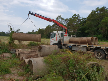 Truck picking up old pipes.jpg
