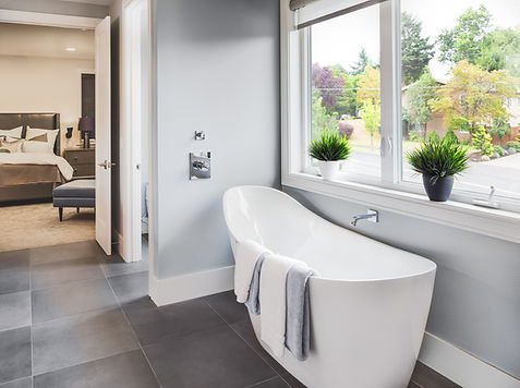 Bathtub in master bathroom in new luxury