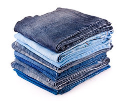 stack of various jeans isolated on white