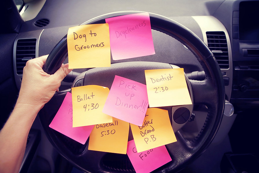 Steering wheel covered in notes as a rem
