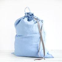 Linen drawstring bag full of laundry on