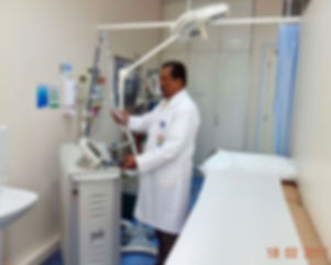 Dr. Sivaprasad setting Erybium Yag laser for skin resurfacing.