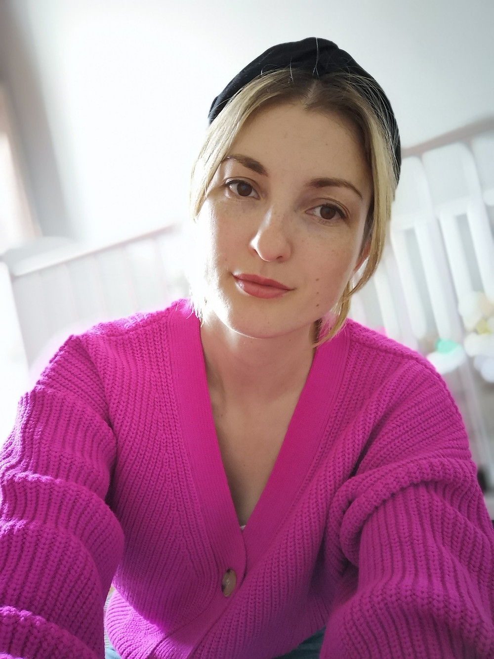 Harriet Goodings wearing a pink cardigan