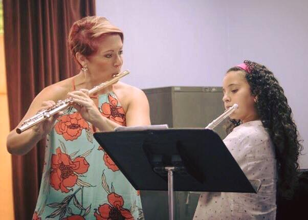 Dr. Beard with a young flute student
