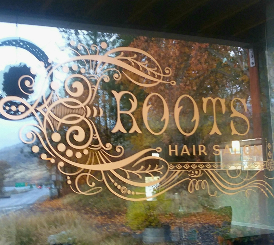 Roots Hair Salon's beautiful logo.