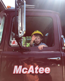 Luca loves to ride along in the trucks