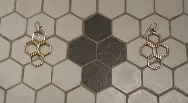 The earrings I had worn that day exactly matched the floor tile pattern, and contemplating tessellation in general, when I suddenly became aware of the bees...