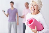 Elderly Woman at Gym Smiling