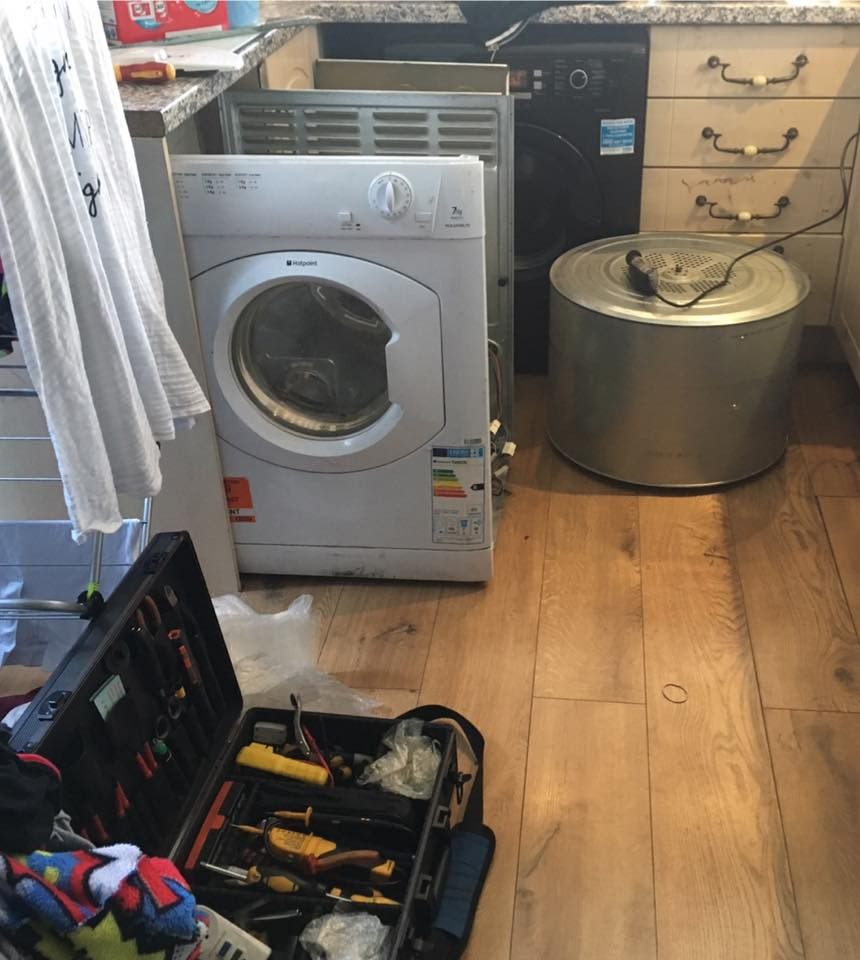 A vented tumble dryer under repair