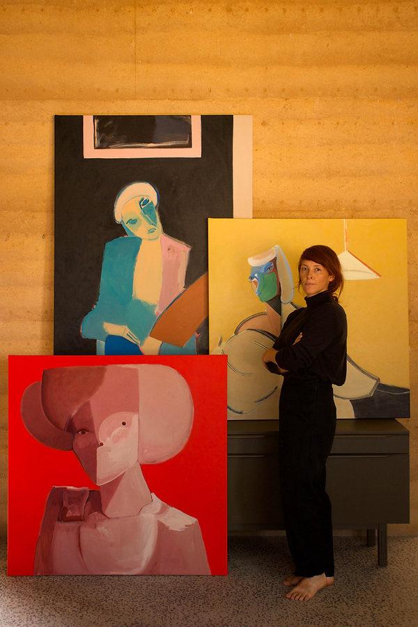 Me with paintings(WEB).jpg