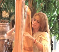 Madhavi plays harp...