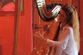 Madhavi Devi, harpist, woman playing harp