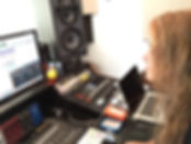 Madhavi works on her music at Spotted Peccary Studios NW