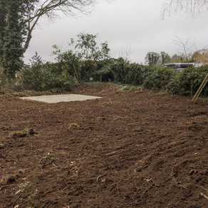 New concrete base installed and garden levelled