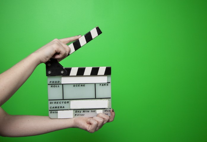 Cinema clap in front of a green screen