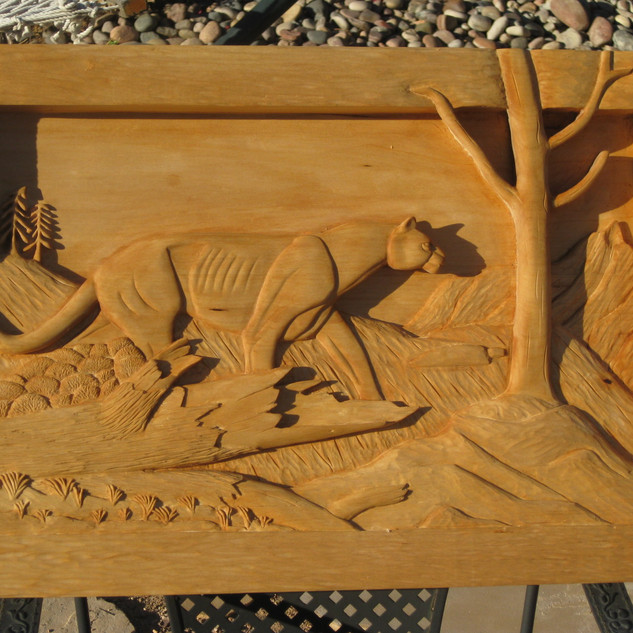 'Cougar on a hill' basswood relief
