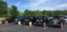 Row of Model A Fords In Parking Lot
