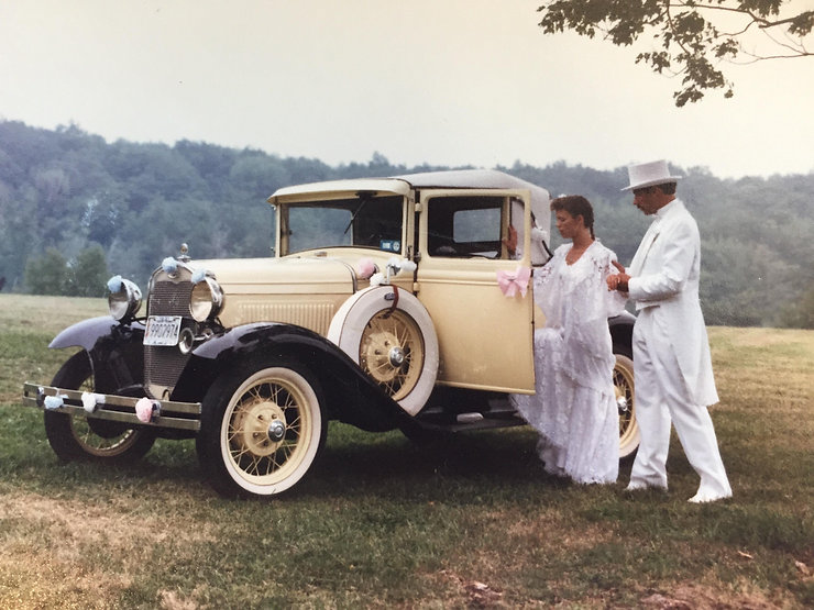 Young Couple With Model A Ford