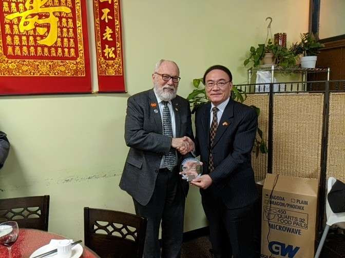 Consul General Wang Donghua presents Oregon China Council Platinum Life Time Achievement Award to State Senator Arnie Roblan, Chair of the Tianjin Sister Relations Association.