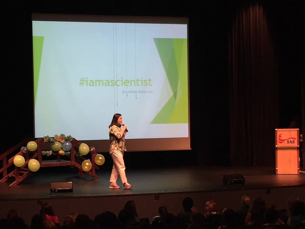 Dr. Hsein-Hsein Lei speaks to the girl scouts.