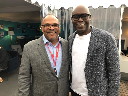 Alfons Adetuyi and Cameron Bailey, Artistic Director & Co-Head of TIFF (Toronto International Film Festival) inside the Canada Pavilion Telefilm Reception at Cannes