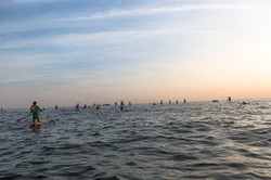 Paddlers from behind at sunrise