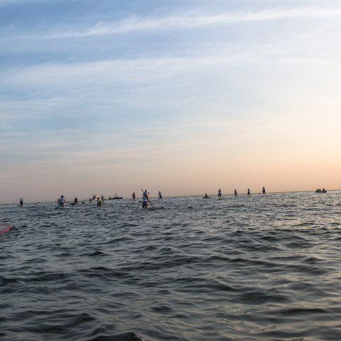Paddlers from behind at sunrise.jpg