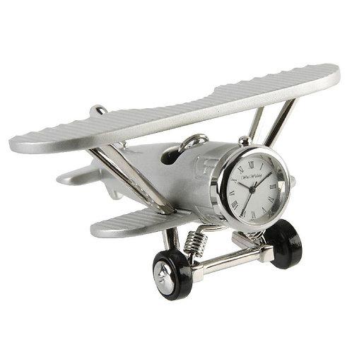 Metal biplane, small clock, desk clock, front view