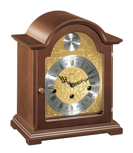 Hermle mantle clock, wood case, gold face roman numerals, front