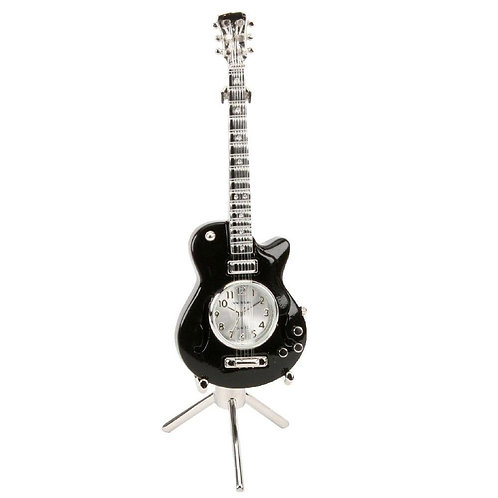 Black guitar, stand, small clock, desk clock, front view