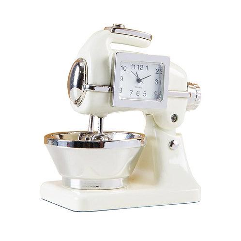 Cream color food mixer, small clock, desk clock, front view