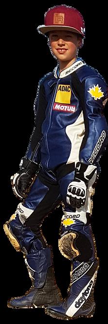 Valentino Herrlich steht in Lederkombi, Handschuhen, Lederstiefel von Daytona und hat ein breites Lächeln.