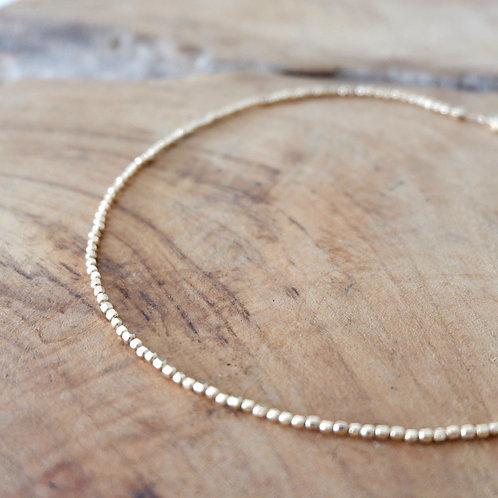 Collier ras de cou perles dorées