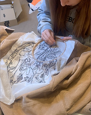 Hand stitching embroidered design on cor