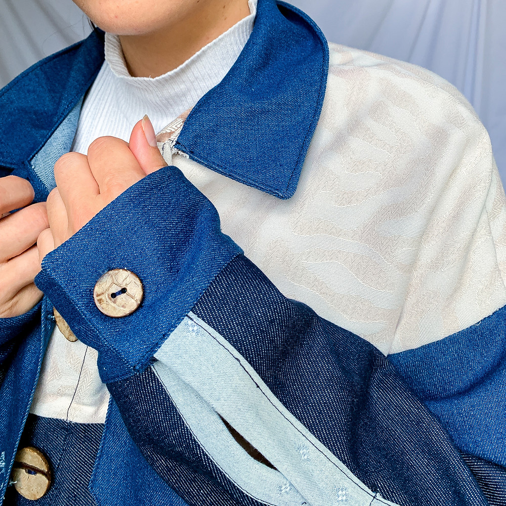 Denim jacket with repurposed fabric panels, secondhand denim and coconut shell buttons
