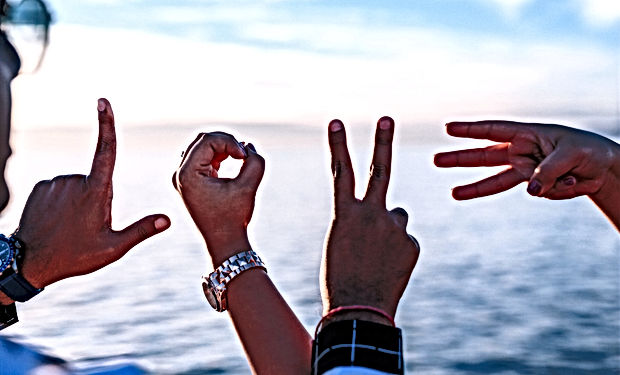 two%20persons%20forming%20love%20fingers
