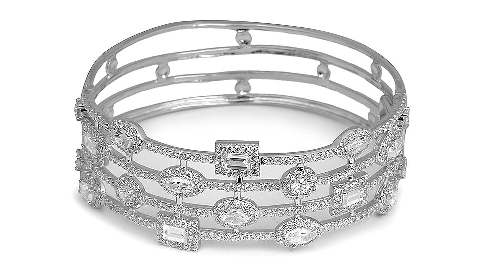 Fancy bangle with cz stones. Hidden clasp