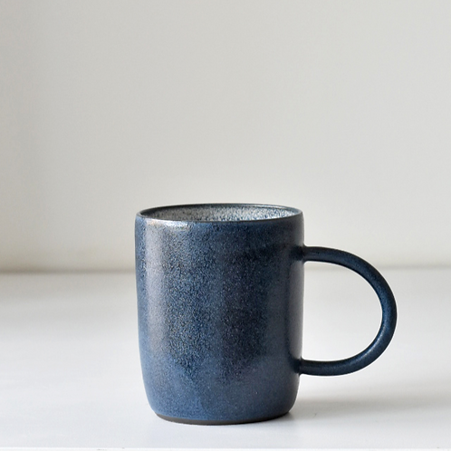 Dark blue cup with handle