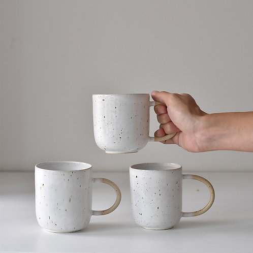 White cup with row handle