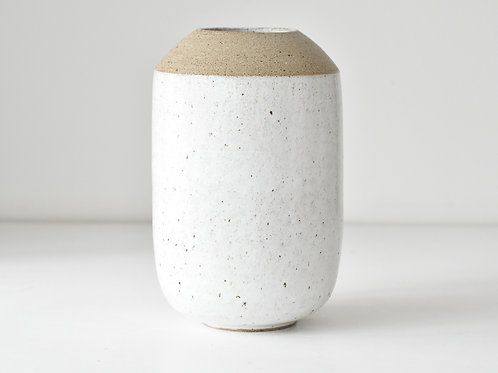 white vase with unglazed rim