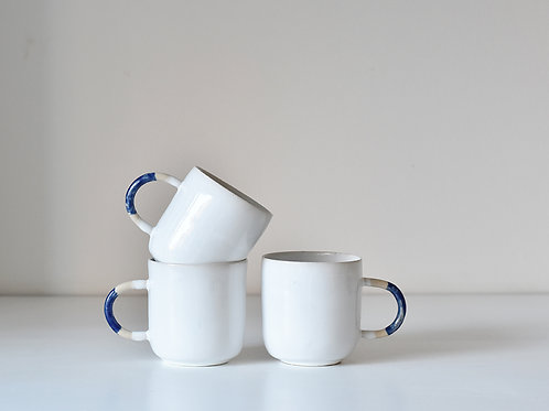 White cup with cobalt handle