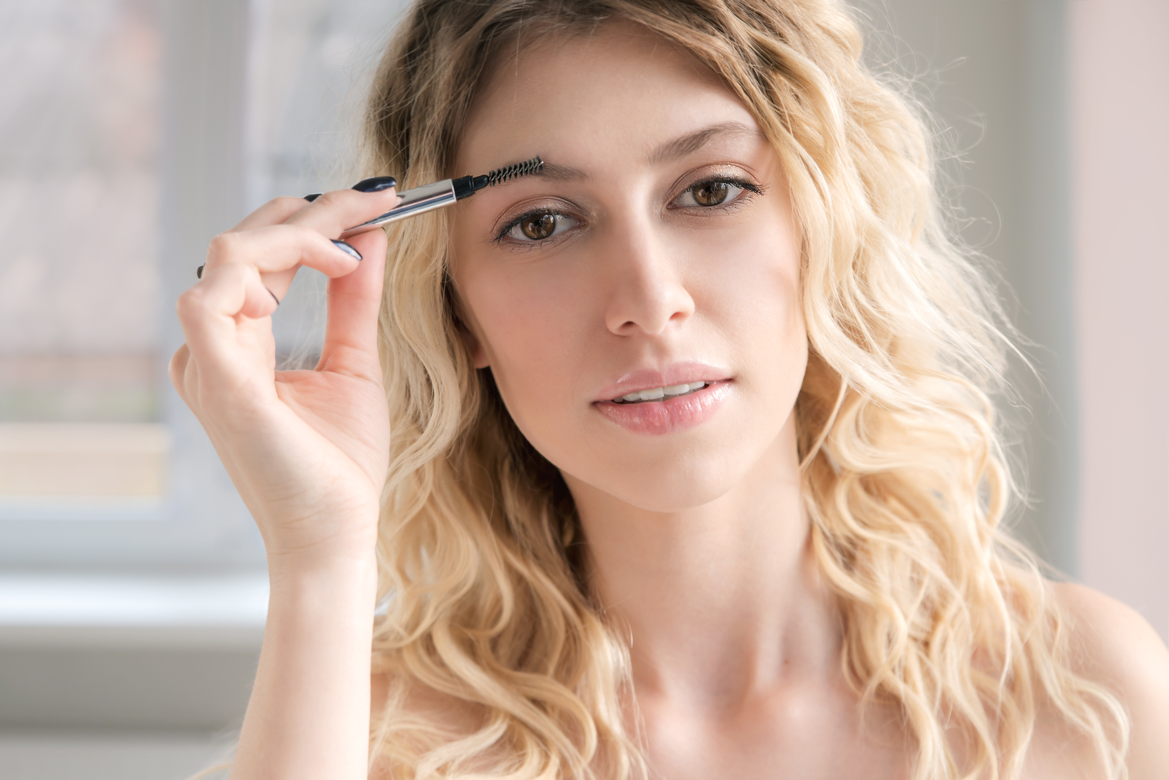 Woman with Brow Brush