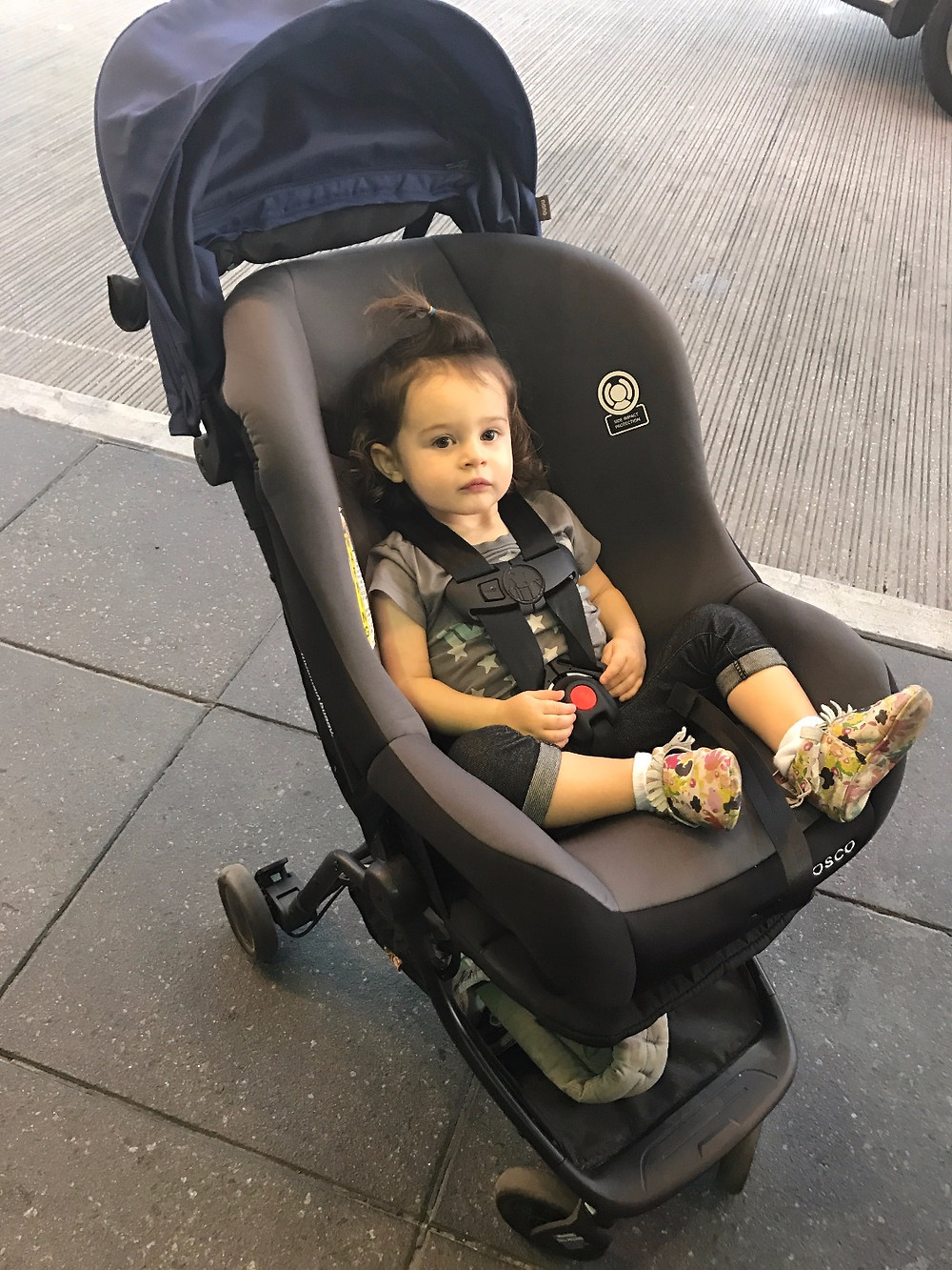 Our travel hack: Cosco Scenera NEXT convertible car seat on top of our Mountain Buggy Nano stroller