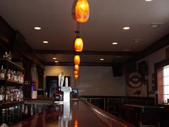 Hanging Lamp Over Bar - A Still Life